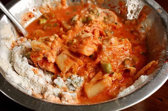 mixing kimchi pancake