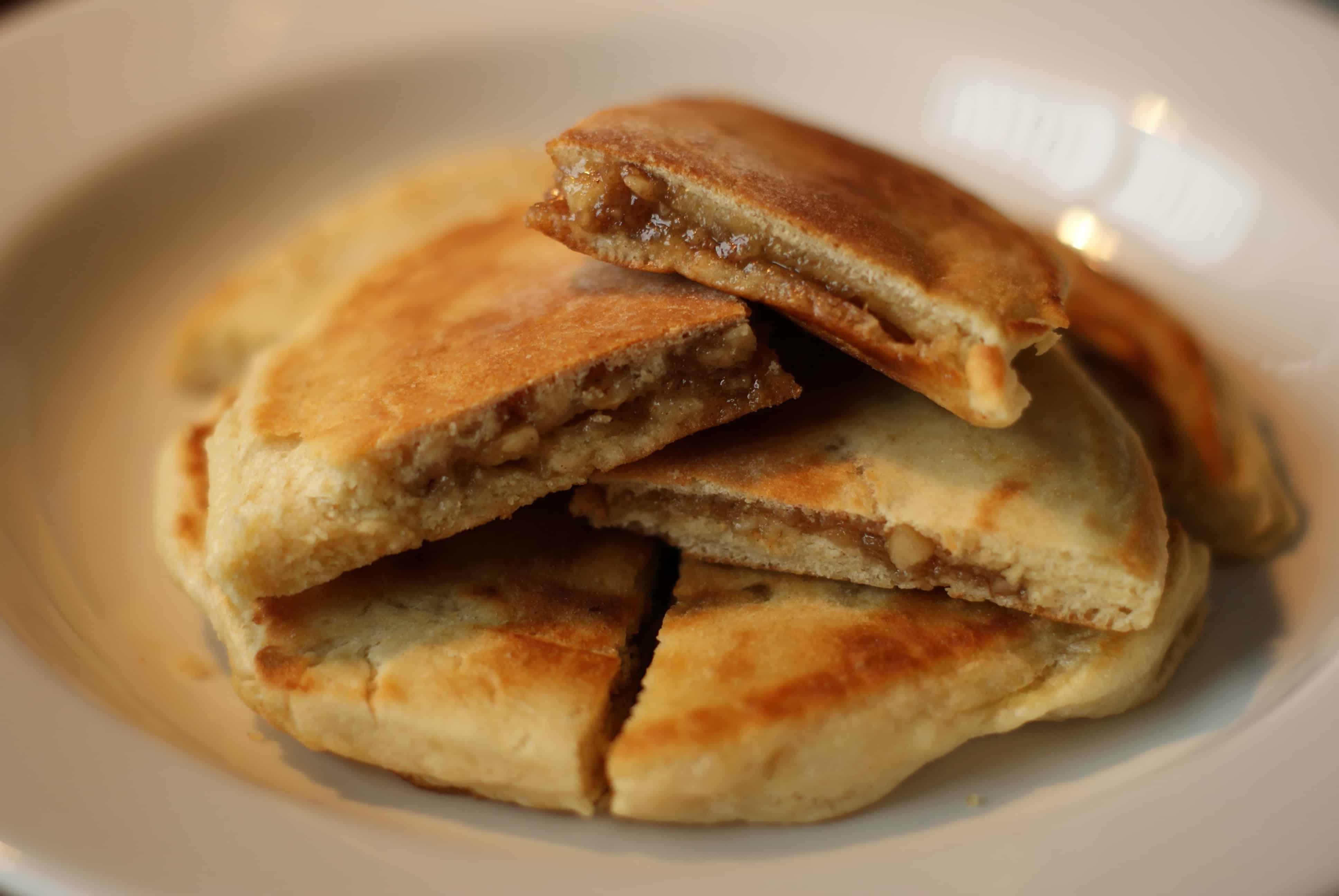 Sweet pancakes with brown sugar syrup filling (hoddeok ... Hoddeok Sweet Korean Pancakes