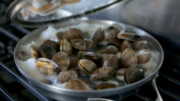Clams boiling and opening